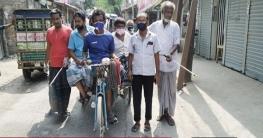 হাইমচরে জনতা বাজারে জীবাণুনাশক স্প্রে